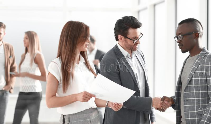 Handshake Manager and client in the office royalty free stock photos