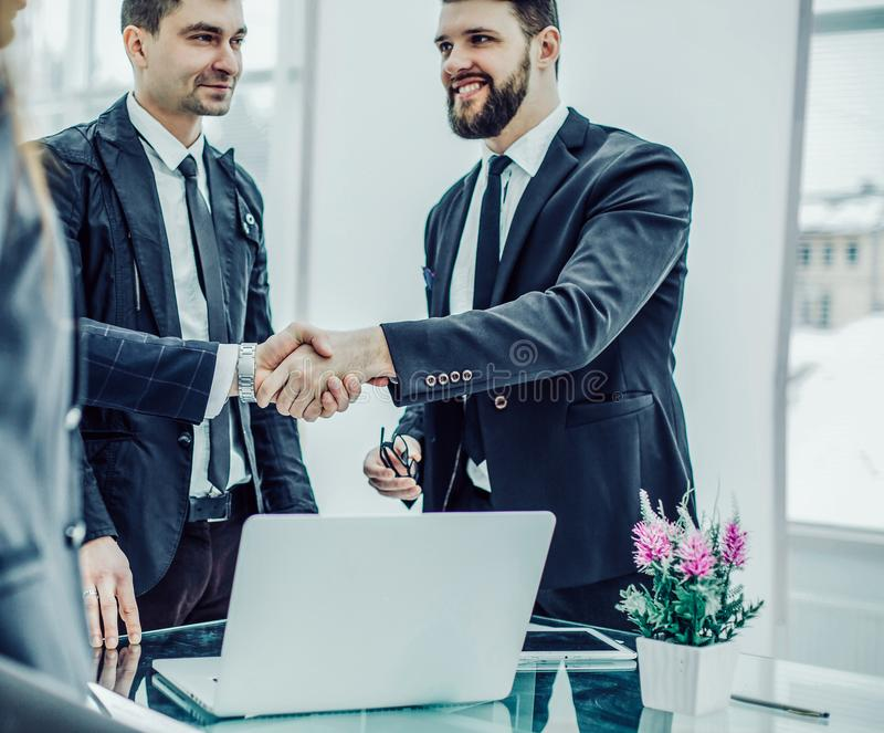 handshake of the Manager and the client prior to conclusion of stock image