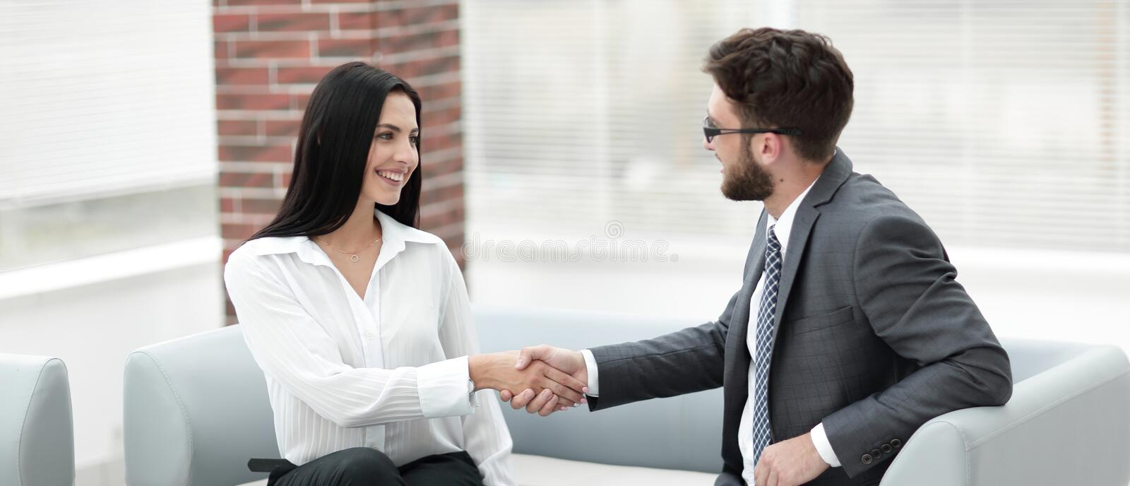 Handshake of manager and client sitting in the office lobby. royalty free stock photos