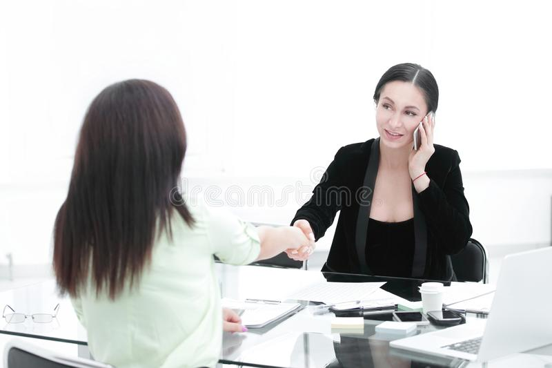 Handshake Manager and client.women`s power in business.photo with copy space stock photography