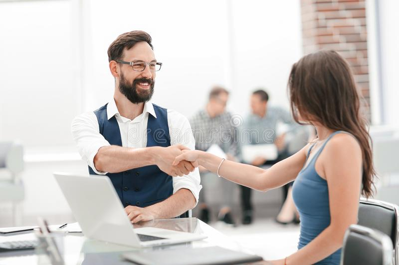 Handshake of a Manager and a customer at the Desk stock photography