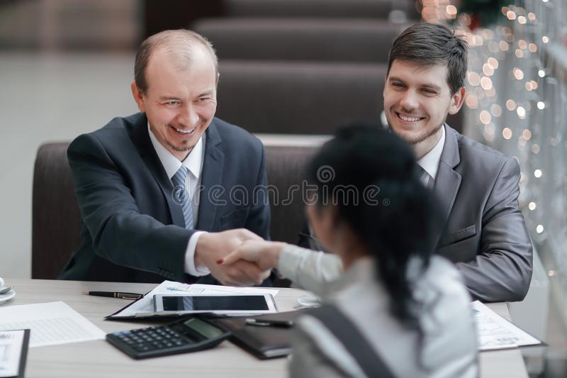 Handshake Manager and customer in a modern office. stock images