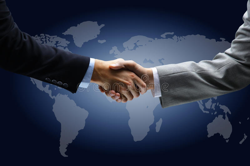 Handshake with map. Of the world in background