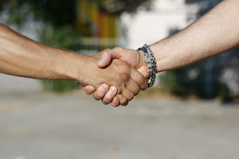 Handshake between men royalty free stock photography