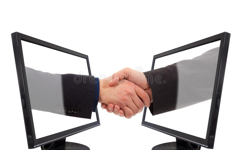 Handshake monitor. Male hands forming a handshake out of a laptopisolated against a white background stock image