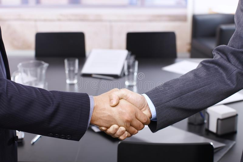 Handshake in office royalty free stock photo