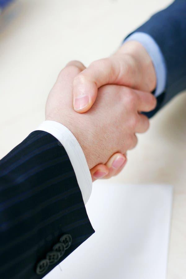 Handshake over paper stock photography