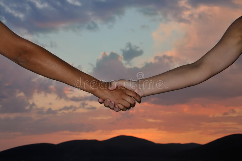 Handshake over sunset royalty free stock image