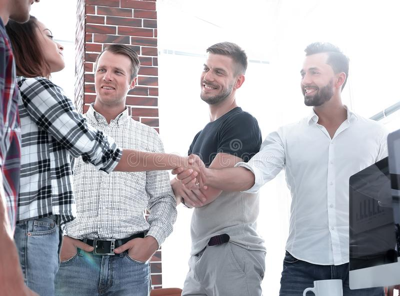 Handshake partners in the creative office. Photo with copy space stock image