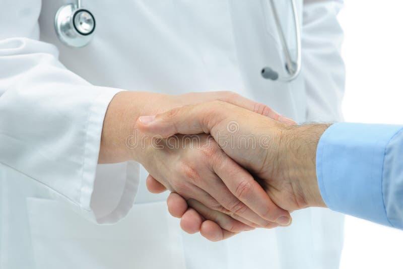 Handshake with patient stock images