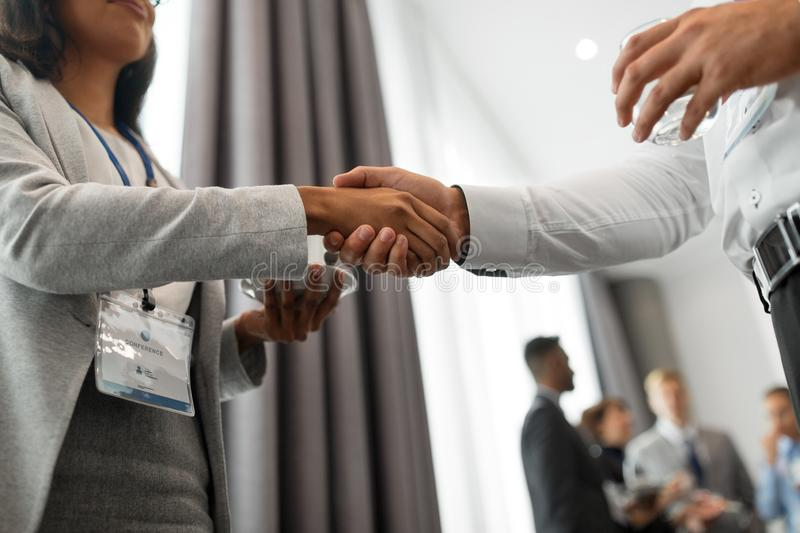 Handshake of people at business conference royalty free stock photography