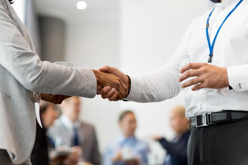 Handshake of people at business conference royalty free stock images