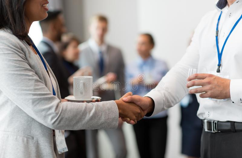 Handshake of people at business conference royalty free stock image