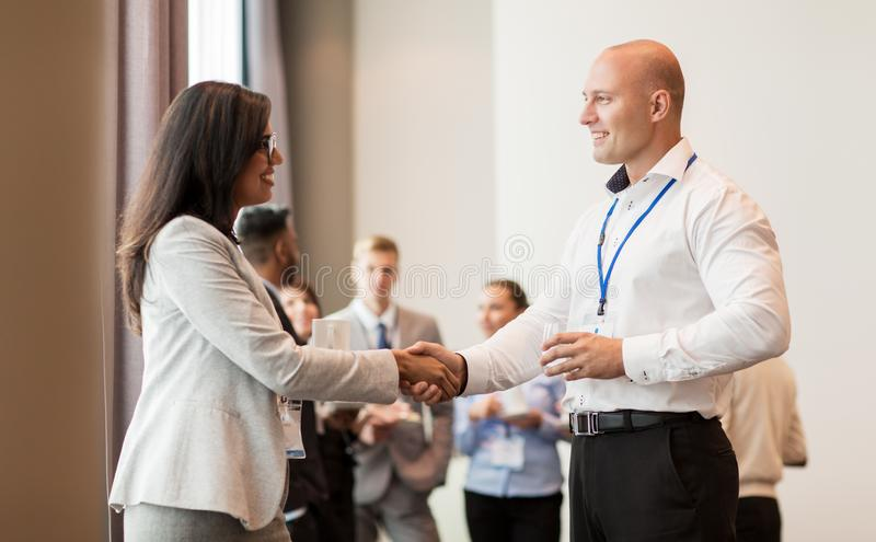 Handshake of people at business conference royalty free stock photo