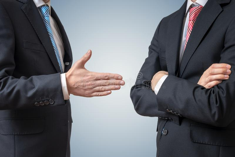 Handshake refuse. Man is refusing shake hand with businessman who is offering his hand. Handshake refuse. Man is refusing shake hand with businessman who is stock images