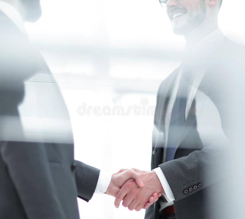 Handshake is serious business partners stock photography