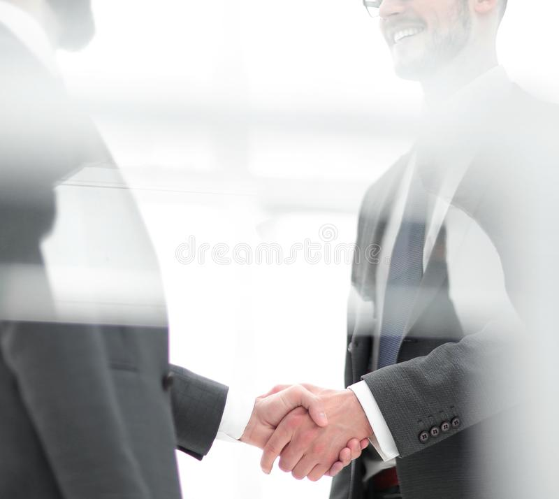 Handshake is serious business partners stock images
