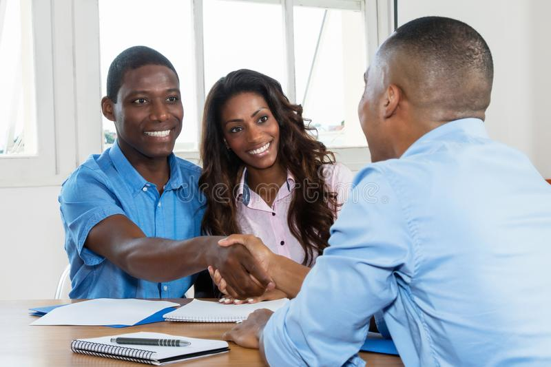 Handshake after signing contract with real estate agent stock photography