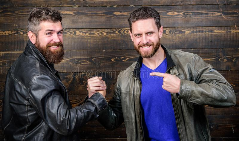 Handshake symbol of successful deal. Approved business deal. Handshake gesture meaning. Have agreed. Brutal bearded men stock photography