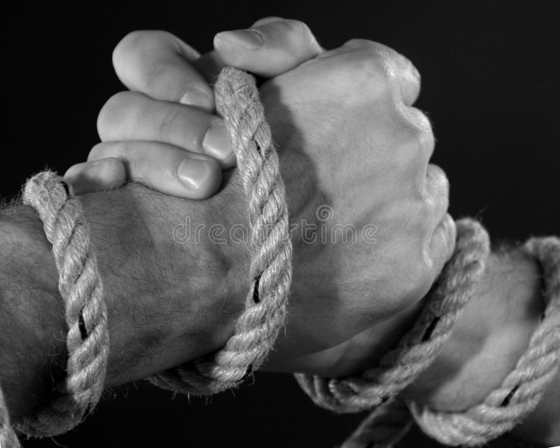 Handshake tied with rope. Closeup image from handshake tied with a rope stock photos
