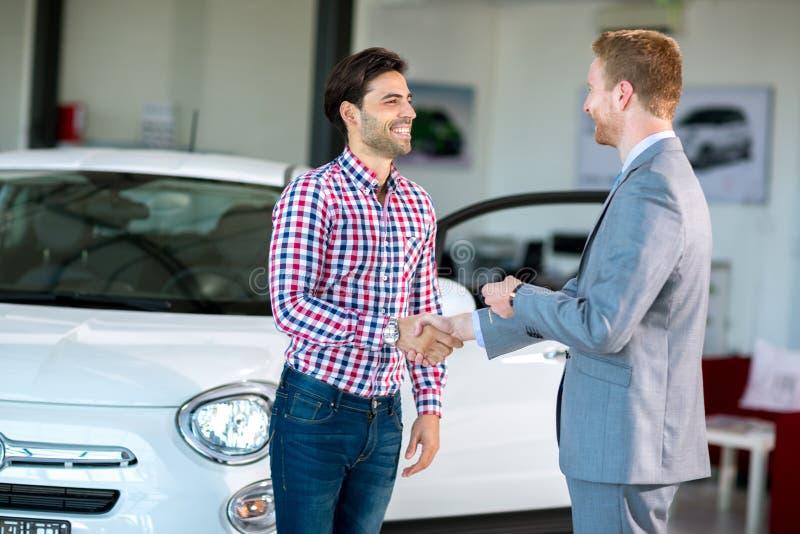Handshake to buy that car stock photo