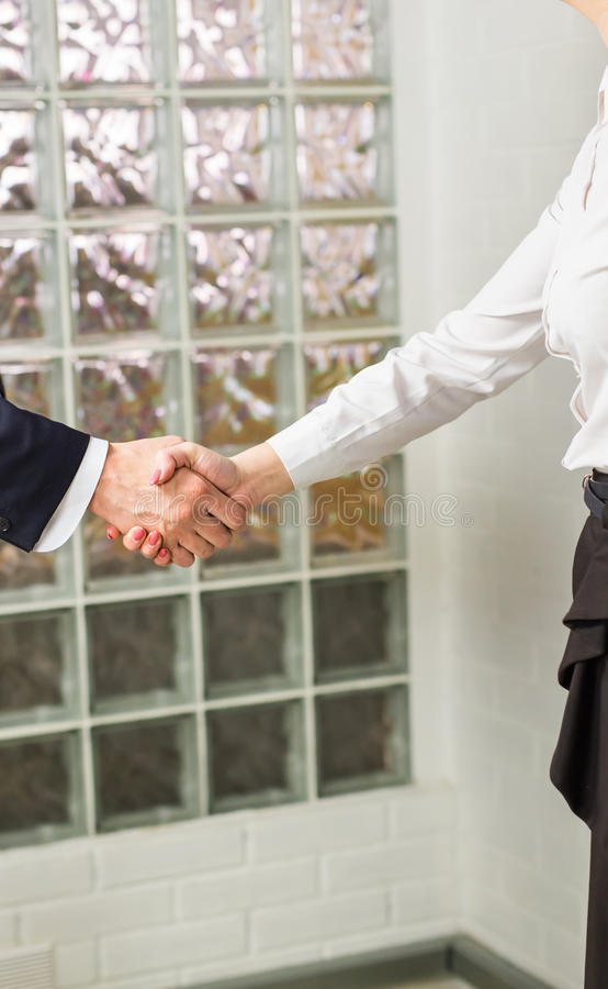 Handshake between two business executives close-up. Handshake between two business executives in office. Close-up royalty free stock images