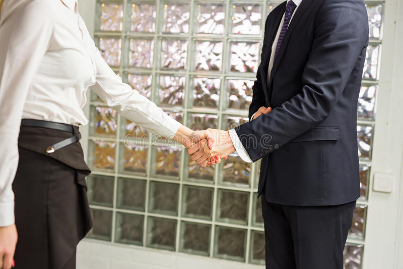 Handshake between two business executives. In office. Close-up royalty free stock images