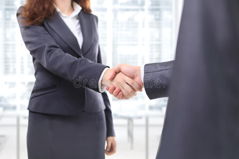 Handshake of the two businessmen royalty free stock image