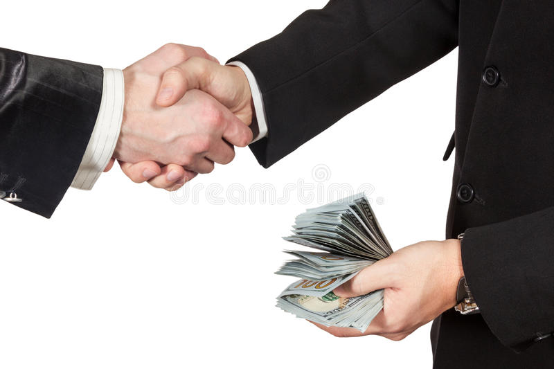 Handshake of two businessmen with money in hand royalty free stock images
