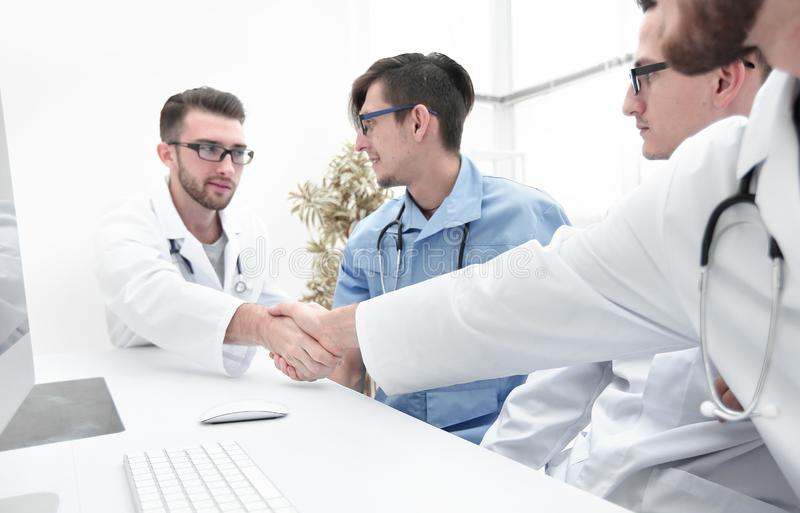 Handshake between the two doctors during the working meeting stock image