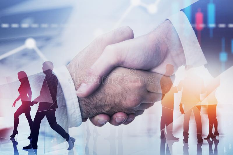 Handshake of two men, business people and graphs royalty free stock photo