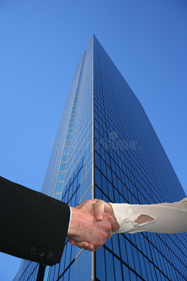 Free Handshake With Tall Skyscraper Royalty Free Stock Photography - 6497367