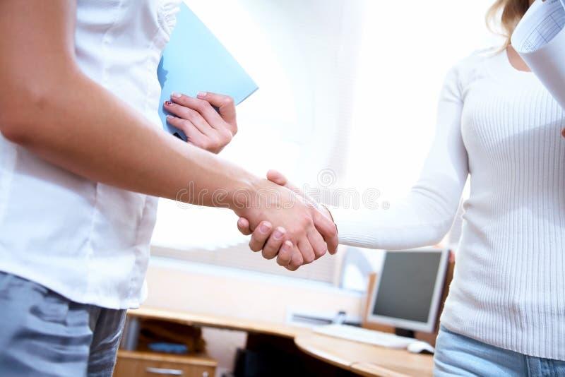 Handshake women?s colleagues royalty free stock photos