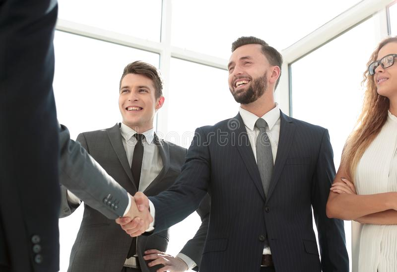 Handshake of young business partners in the office stock photos