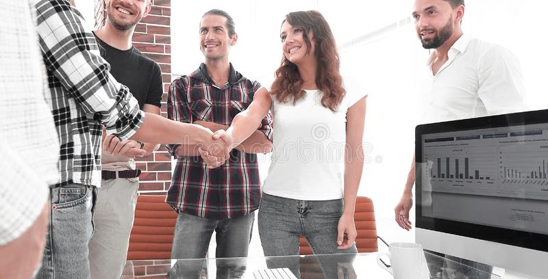 Handshake of young designers and client royalty free stock photography