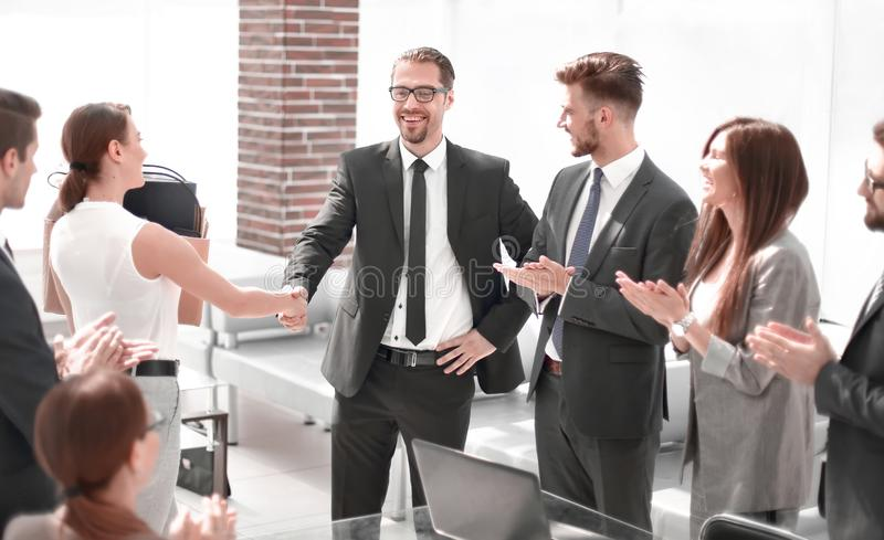 Handshake of a young employee with the project Manager royalty free stock images