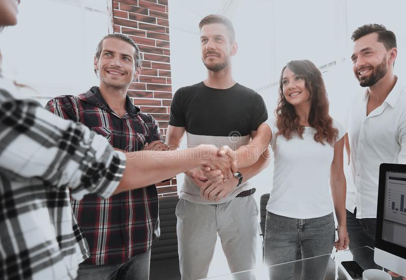 Handshake of young people royalty free stock images
