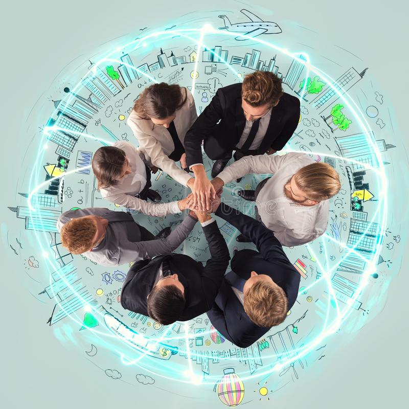Handshaking business person above a round and ccreative drawing. concept of teamwork and partnership. Group of business men and women make an agreement royalty free stock image