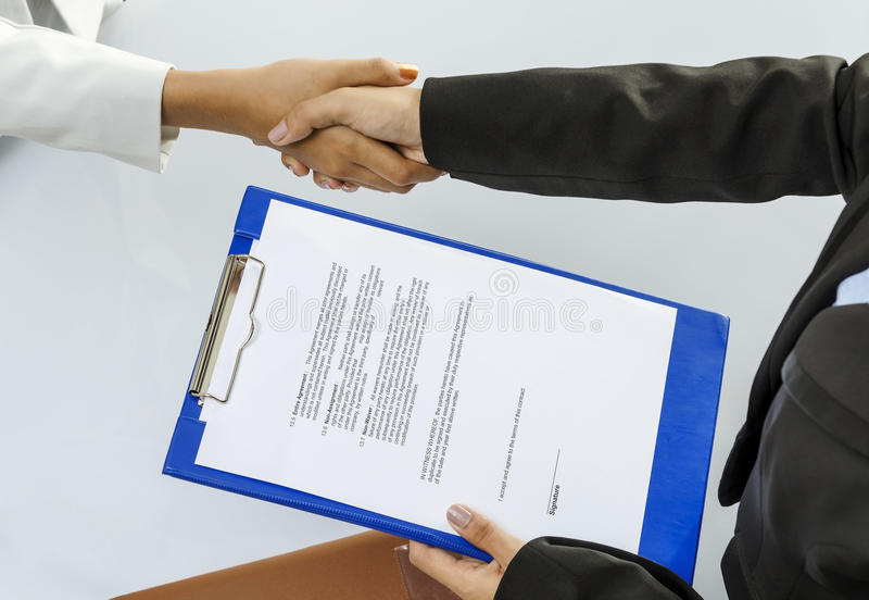 Handshaking. Business person handshaking for contract deal stock photos