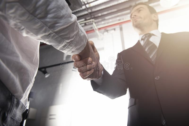 Handshaking business person in office. concept of teamwork and partnership. Handshaking business person in the office. concept of teamwork and business stock photo