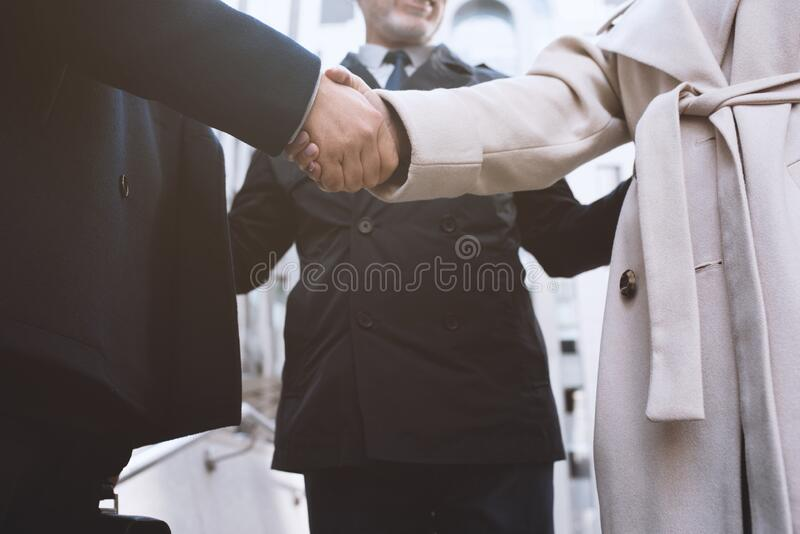 Handshaking business person in office. concept of teamwork and partnership. royalty free stock photo