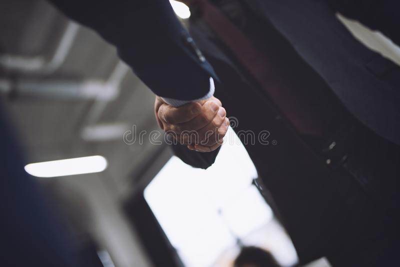 Handshaking business person in office. concept of teamwork and partnership. Handshaking business person in the office. concept of teamwork and business royalty free stock image