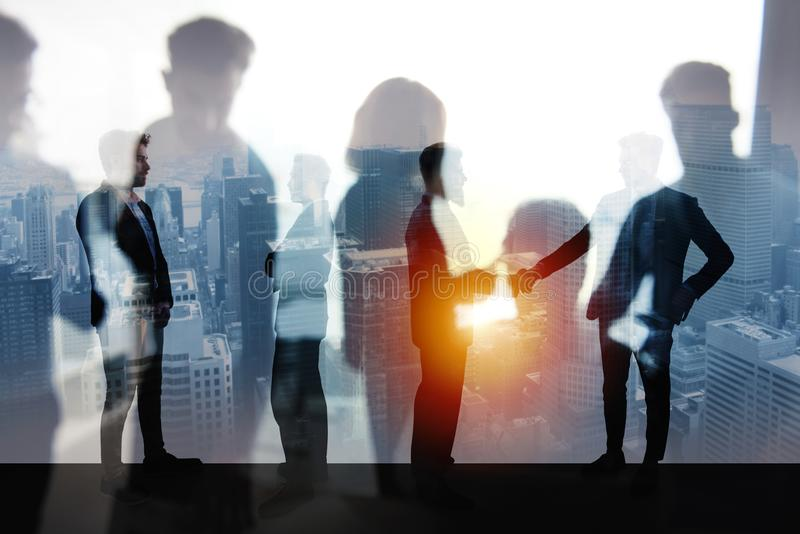 Handshaking business person in office. concept of teamwork and partnership. double exposure royalty free stock photography