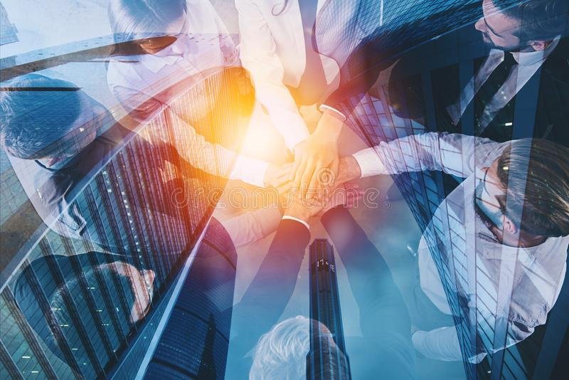 Handshaking business person in office. concept of teamwork and partnership. double exposure with light effects. Group of young people make an agreement in the stock illustration