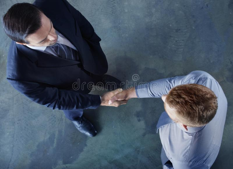 Handshaking business person in office. concept of teamwork and partnership. Handshaking business person in the office. concept of teamwork and business stock photos