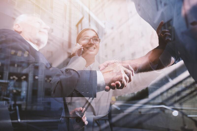 Handshaking business person in office. concept of teamwork and partnership. stock photo