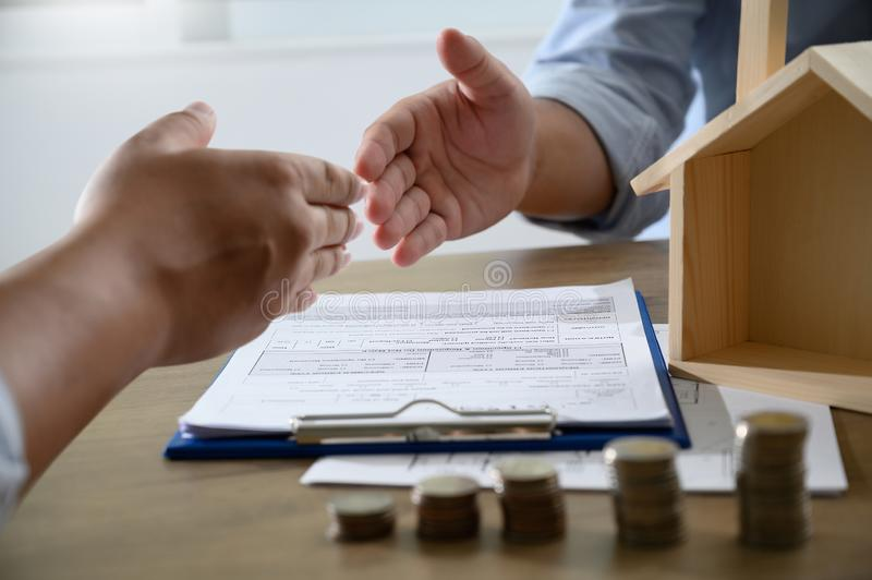 Handshaking caucasian broker Real Estate and Agreement concept. D stock photos