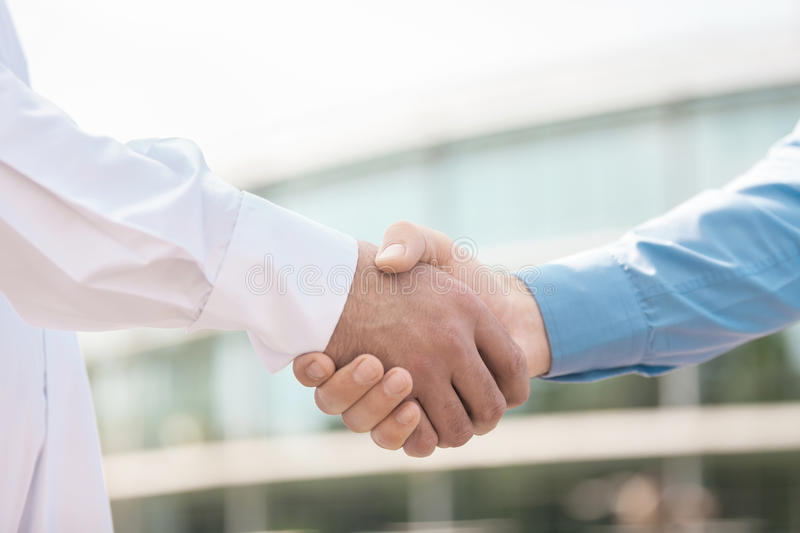 Handshaking. Close-up of handshaking outdoors royalty free stock photos