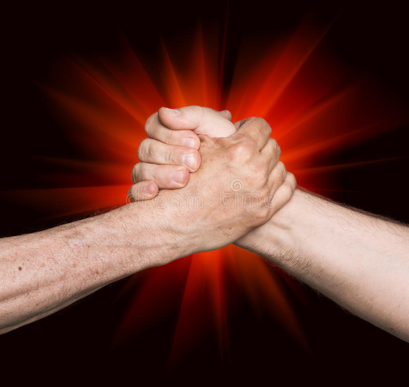 Handshaking. Man's handshake isolated on an abstract background of a red star royalty free stock photo