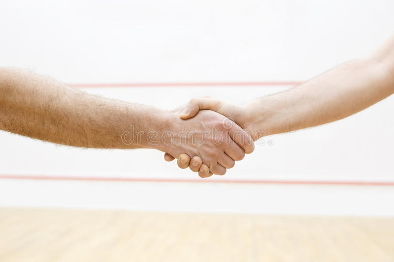 Handshaking before match stock images